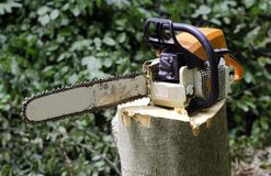 Chainsaw. Placed on a tree stump royalty free stock image
