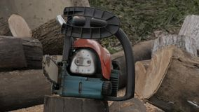 Chainsaw on the background of sawn logs. slow motion stock video footage