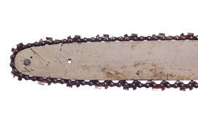 Chainsaw blade. Dirty blade of a chainsaw, isolated against ackground stock photography