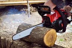 Chainsaw blade cutting Royalty Free Stock Images