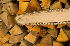 Chainsaw blade and Wood Stock Photography