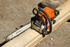 Chainsaw on the boards. Bright spring day Royalty Free Stock Images