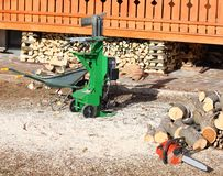 Chainsaw in the carpentry to cutting to wooden logs. In the yard stock photography