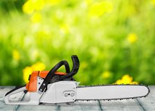 Chainsaw. Gardening equipment orange work tool equipment close to lumber industry royalty free stock photography