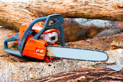Chainsaw closeup. On a felled forest Royalty Free Stock Photography