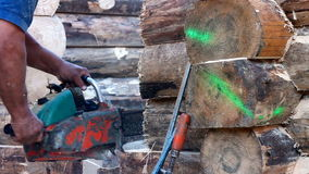Chainsaw cutting wood stock footage