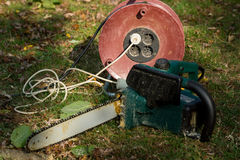 Chainsaw. An electric chainsaw in the garden royalty free stock image