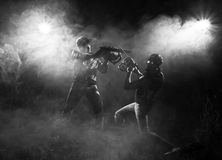 Chainsaw fight. Between two men and abstract smoke stock images