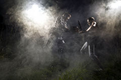 Chainsaw fight. Between two men and abstract smoke royalty free stock photos