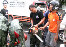 Chainsaw. Firefighters set up a chainsaw to cut the tree collapsed in the city of Solo, Central Java, Indonesia royalty free stock photography