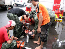 Chainsaw. Firefighters set up a chainsaw to cut the tree collapsed in the city of Solo, Central Java, Indonesia stock photo