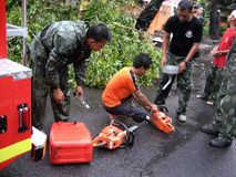 Chainsaw. Firefighters set up a chainsaw to cut the tree collapsed in the city of Solo, Central Java, Indonesia royalty free stock image