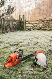 Chainsaw in the garden Stock Photo