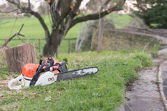 Chainsaw on the ground Royalty Free Stock Photo