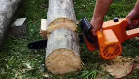 Chainsaw in the hands Stock Photography