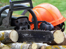 Chainsaw and helmet. Equipment for working in the woods Stock Photography