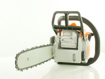 Chainsaw over white background Royalty Free Stock Images