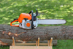 Chainsaw. Petrol Chainsaw at Big Wood Log royalty free stock photos