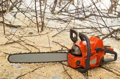 How do you like this chainsaw?. A chainsaw is a portable, mechanical saw which cuts with a set of teeth attached to a rotating chain that runs along a guide bar royalty free stock photography