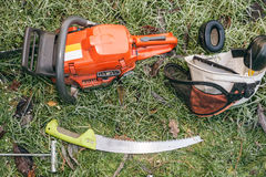 Chainsaw and pruning handsaw Royalty Free Stock Image