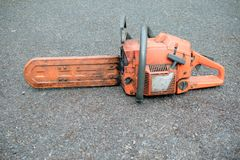 A chainsaw ready to use. A well used chainsaw used by a tree surgeon royalty free stock photography