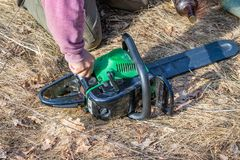 Chainsaw refueling with gasoline and oil. For further work stock images