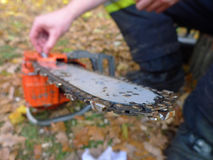 Chainsaw repairing. Repair of chainsaw in the garden royalty free stock images