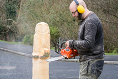 Chainsaw Sculptor Stock Image