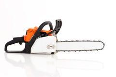 Chainsaw som isoleras på vit fotografering för bildbyråer