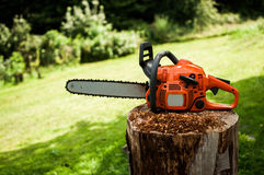 Chainsaw. On a stump with a sawdust stock photos