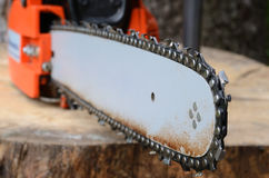 Chainsaw on the stump. Selective focus stock photos