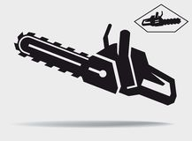 Chainsaw. Vector black icon on a grey background Royalty Free Stock Images