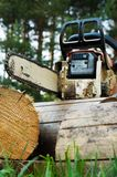 Chainsaw on wood cuttings Stock Photos