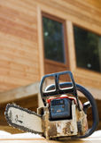 Chainsaw on wood cuttings. (Shallow DOF Stock Images