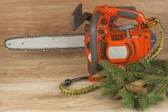 Chainsaw on a wooden background. Small saw for pruning. Stock Image