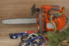 Chainsaw on a wooden background. Small saw for pruning. Royalty Free Stock Photos