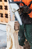 Chainsaw work for figural decoration log Royalty Free Stock Image