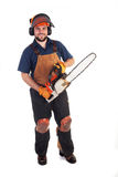 Chainsaw Worker. A man holding a chainsaw isolated on a white background royalty free stock photo