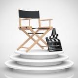 Chair主任,电影拍板和扩音机在圆的阶段 3d 库存照片
