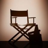 Chair主任,电影拍板和扩音机有背后照明的 免版税库存图片