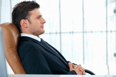In The Chair. A young business manager is sitting relaxed in chair Royalty Free Stock Photography