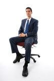 On the chair. Man in blue suit sitting on a chair Stock Photos