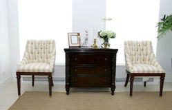 Chair. Two chairs for relaxing in the living room beside the table Stock Photography