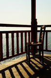 Chair. A chair on wooden balcony at sunset, Greece royalty free stock photography