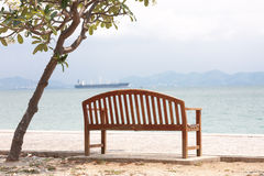 The Chair. The one chair placed near  the sea for all people to travel and relax Stock Photos