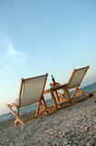 Chair. Set of chair on sunset beach stock photography