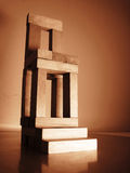 Chair. A chair made with wooden block, metaphor step for wealth and power, leadership Royalty Free Stock Photography