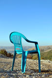 Chair. Lonely chair which is highly in mountains Royalty Free Stock Image