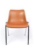 Chair. A tan chrome legged chair stock photography