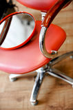 Chair. Red chair wirh red mirror Royalty Free Stock Photo